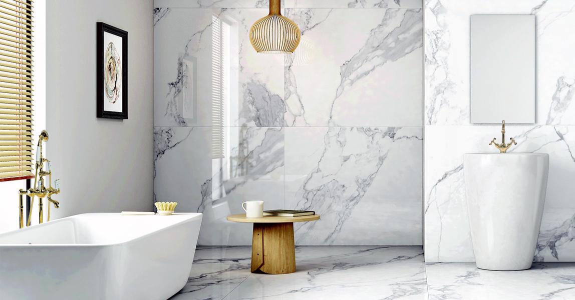 baño de diseño marmol y dorado bronces mestre